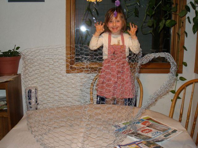 """Chicken wire frame tea cup for """"fairy taking a bath in teacup"""" costume. My little fairy in the background :)"""